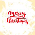 Merry Christmas - lettering Christmas and New Year holiday calligraphy phrase  on the background. Fun brush ink Royalty Free Stock Photo