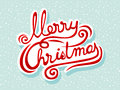 Merry christmas lettering hand drawn on a snowy background Royalty Free Stock Photo