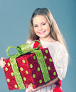 Merry christmas little girl holding a big red gift boxes Stock Photo