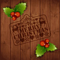Merry christmas with mistletoe greeting card about on wooden background Royalty Free Stock Photography
