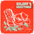 merry christmas and New Year red card with cowboy boot and western hat Royalty Free Stock Photo