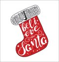 Merry Christmas quote lettering  I believe in Santa in red stocking shape Royalty Free Stock Photo