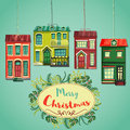 Merry Christmas retro card. Vintage cartoon city houses and wreath of christmas plants. Royalty Free Stock Photo