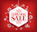 Merry Christmas Sale in Winter Snow Flakes Hanging Royalty Free Stock Photo
