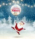Merry Christmas. Santa Claus with Big transparent realistic balloon confetti in snow scene. Winter Christmas Woodland Landscape wi Royalty Free Stock Photo