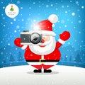 Merry christmas Santa claus hand holding photo camera Royalty Free Stock Photo