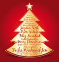 Merry christmas in several languages in a golden christmas tree red greeting card with Royalty Free Stock Images