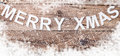 Merry Christmas sign on wooden background with copy space Royalty Free Stock Photo