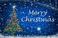 Merry Christmas Sparkly Tree on Starry Sky Stock Photo