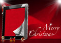 Merry christmas tablet computer with red velvet pages objects with word marry on red velvet background Stock Photography
