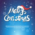 Merry Christmas Text Decorated With Red Santa Hat Over Blue Snowflakes Background Greeting Card Copy Space Royalty Free Stock Photo
