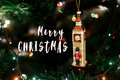 Merry christmas text sign on  Queen`s guard near big ben christm Royalty Free Stock Photo