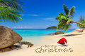 Merry christmas from the tropical beach with santa hat on Royalty Free Stock Photography