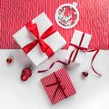 Merry Christmas Typographical on white and red paper background with gift boxes, red decoration. Royalty Free Stock Photo