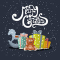 Merry christmas vector xmas greeting card with gift boxes and toys Royalty Free Stock Image