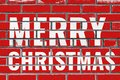 Merry Christmas greeting text on red bricks wall Royalty Free Stock Photo