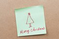 Merry christmas words written on a sticky note Royalty Free Stock Photos