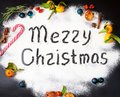 Merry Christmas written on flour and Decorations. New Year card. Royalty Free Stock Photo