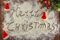 Merry christmas written with flour Royalty Free Stock Photo