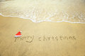 Merry Christmas written on tropical beach white sand Royalty Free Stock Photo