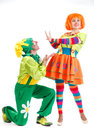 Merry clowns two at studio white background Royalty Free Stock Photo