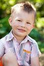 Merry disheveled boy Royalty Free Stock Photo