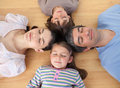 Merry family sleeping lying on the floor Royalty Free Stock Images