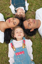 Merry family sleeping lying on the grass Royalty Free Stock Photos