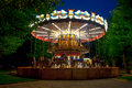Merry go round carousel in the amusement park at evening Stock Photography