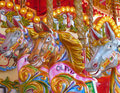 Merry go round or carousel horses close up of brightly coloured on traditional fairground Stock Photos
