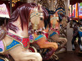 Merry go round carousel horses details Stock Photos
