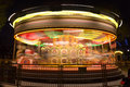 Merry go round, carousel, in motion at night