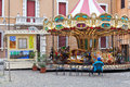 Merry-go-round carousel on town square Royalty Free Stock Photo