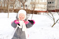 Merry little girl playing in the snow Royalty Free Stock Images