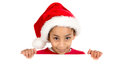 Merry x mas happy young girl with santa s hat posing with big board Stock Photo