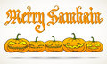 Merry samhain greeting card hand calligraphy inscription big pagan festival with row of traditional pumpkins Stock Photo