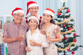 Merry smiles portrait of a family smiling happily on a christmas day Royalty Free Stock Photos