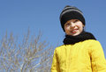 Merry ukrainian girl cheerful in a yellow jacket on a background of blue sky Stock Image