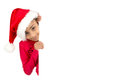 Merry xmas happy young girl with santas hat posing with big board Stock Photo