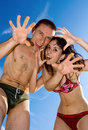 The merry young couple in swimsuits Stock Photos