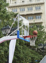 Mesh basketball and ball summer in the city Stock Photos