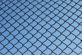Mesh netting on the background of blue sky Stock Photos