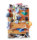 Mess dresser with scattered clother clothes shoes and other things Stock Image