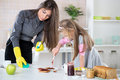 Mess with jam in the kitchen angry overworked businesswoman cleaning table morning and late for work because her daughter making Stock Images