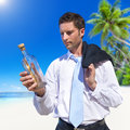 Message in a bottle at beach Royalty Free Stock Images
