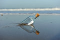Message in a bottle on the beach Royalty Free Stock Photo