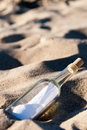 Message in a bottle in the sand Stock Photography