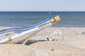 Message in a bottle on the sandy beach Royalty Free Stock Images