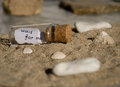 Message in a bottle small with on beach Stock Photos
