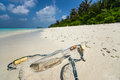 Message in a bottle washed ashore on a tropical beach maldives Stock Photography